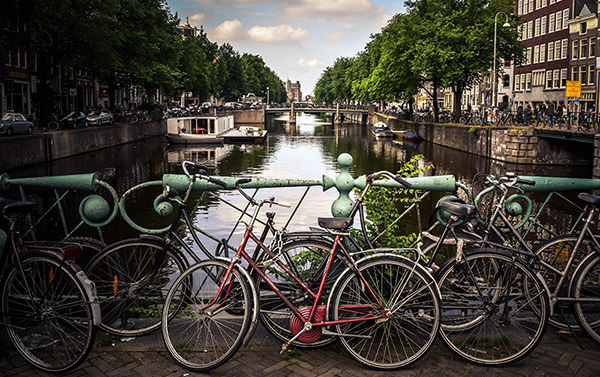 Bicycles parked on a canal bridge in Amsterdam