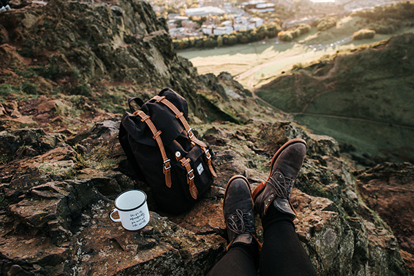 Hipster backpack resting on mountain trail