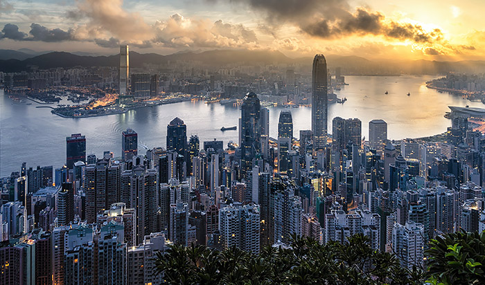Sunset skyline of Hong Kong and Kowloon from Victoria Peak