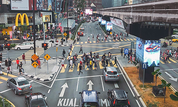 Traffic and intersection on a road in Kuala Lumpur