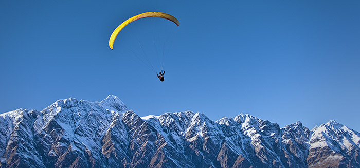 Person paragliding in Queenstown, New Zealand