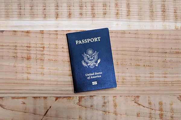 USA passport on wooden table