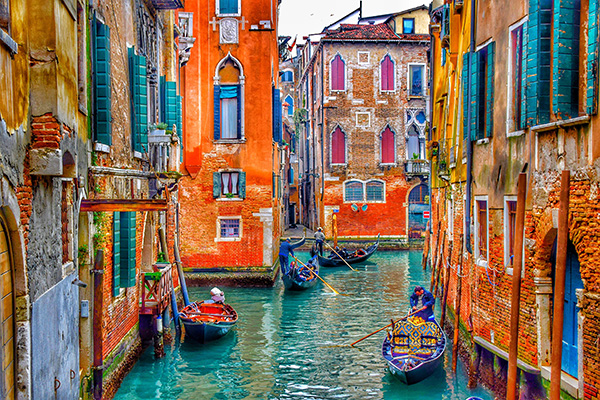 Boats moving through Venice's colorful canals