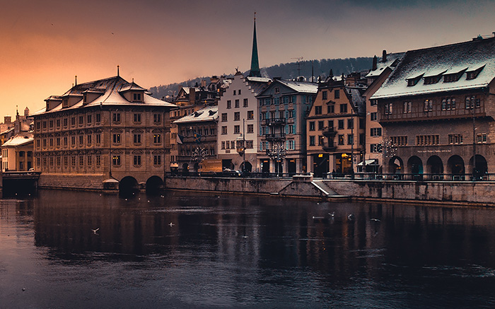 Buildings on waterfront during sunset, Zurich